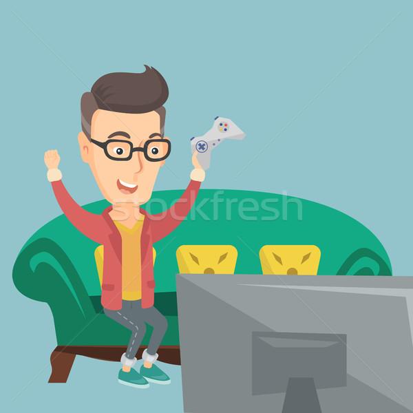 Homem jogar jogo vídeo caucasiano animado moço Foto stock © RAStudio