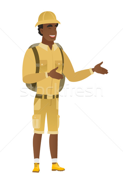 Stock photo: Young african-american happy traveler gesturing.