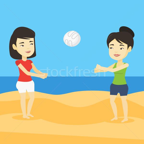 Duas mulheres jogar praia voleibol dois asiático Foto stock © RAStudio