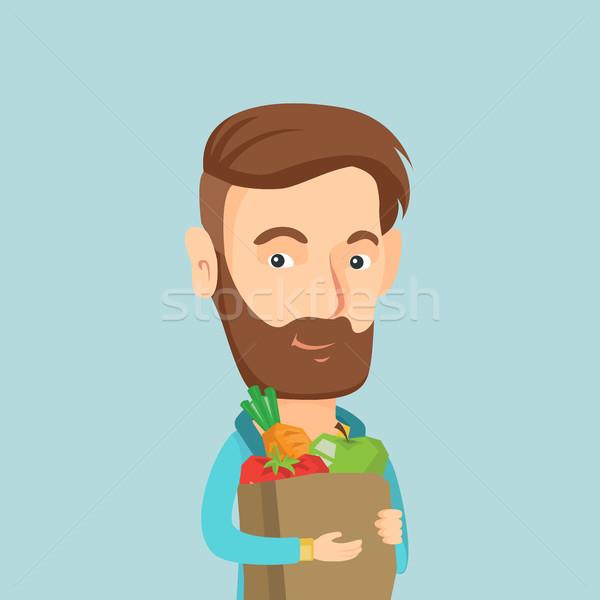 Stock fotó: Boldog · férfi · tart · élelmiszer · bevásárlószatyor · fiatal