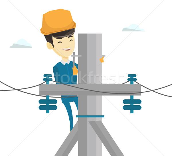 Elektryk pracy elektryczne moc słup asian Zdjęcia stock © RAStudio