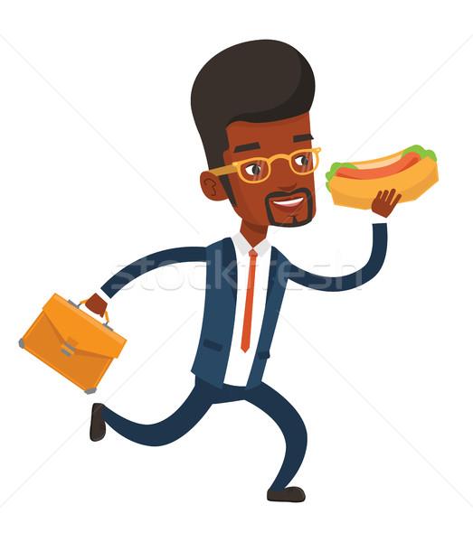 Imprenditore mangiare hot dog fretta valigetta eseguire Foto d'archivio © RAStudio