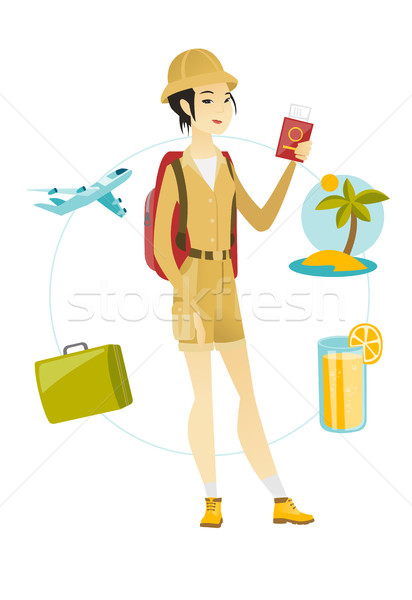 Young woman traveler holding passport with ticket. Stock photo © RAStudio