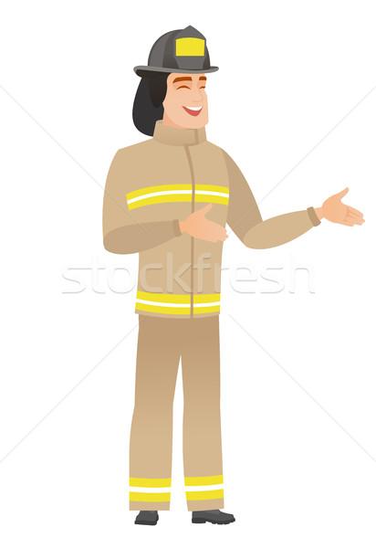 Young caucasian happy firefighter gesturing. Stock photo © RAStudio