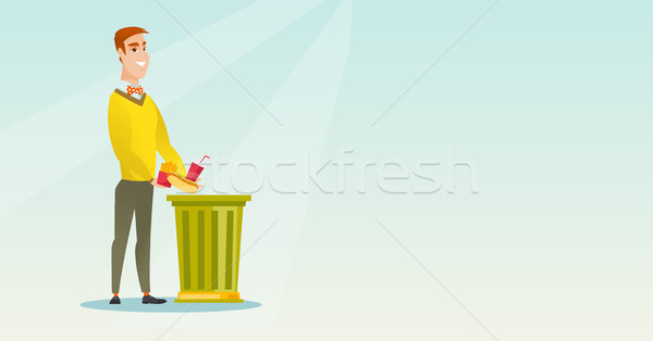 Férfi dob egészségtelen étel kaukázusi szemét tároló Stock fotó © RAStudio