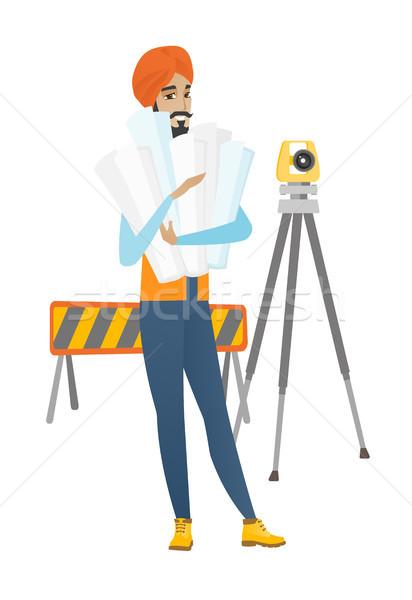 Hindu engineer holding twisted blueprints. Stock photo © RAStudio