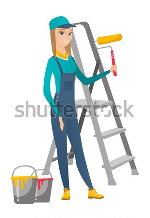 Hindu house painter holding paint roller. Stock photo © RAStudio