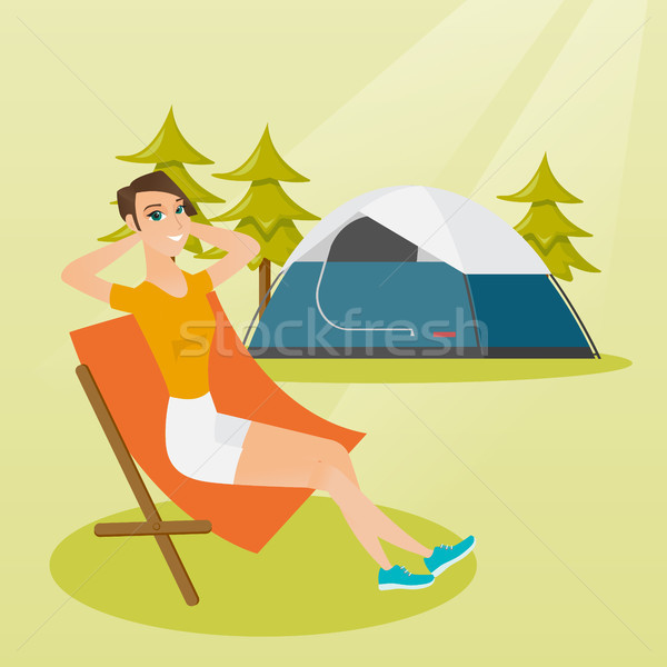 Woman sitting in a folding chair in the camping. Stock photo © RAStudio