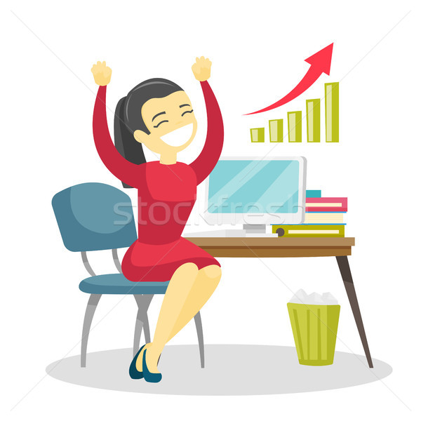 Successful entrepreneur celebrating at workplace. Stock photo © RAStudio