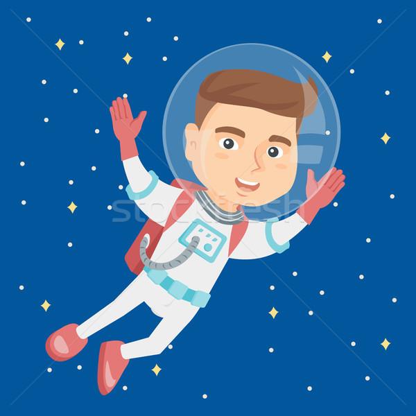 Caucasiano astronauta criança terno voador espaço Foto stock © RAStudio