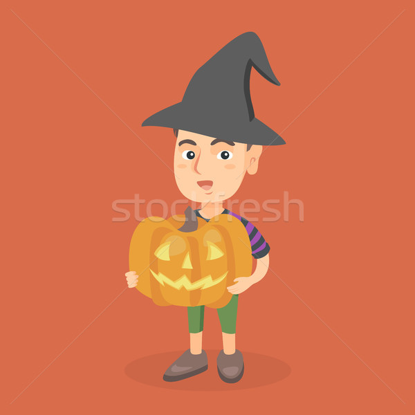Young boy holding a carved pumpkin for Halloween. Stock photo © RAStudio
