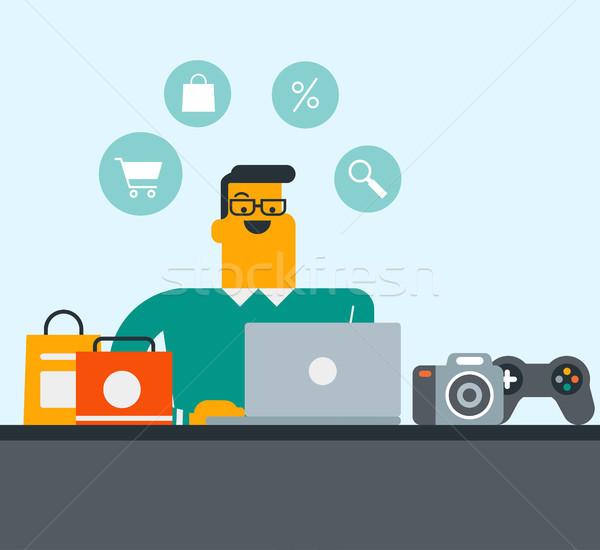 Młodych biały człowiek zakupy online posiedzenia Zdjęcia stock © RAStudio