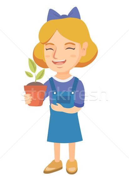 Caucasian smiling girl holding a potted plant. Stock photo © RAStudio