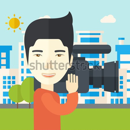 Cameraman with video camera Stock photo © RAStudio