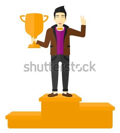 Cheerful man on pedestal. Stock photo © RAStudio