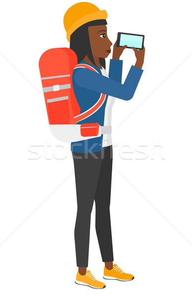 Backpacker taking photo. Stock photo © RAStudio