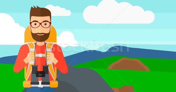 Cheerful backpacker with binoculars. Stock photo © RAStudio