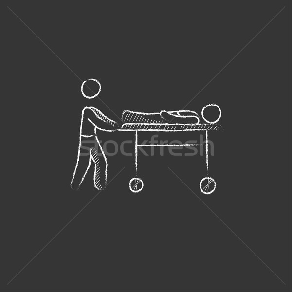 Stock photo: Man pushing stretchers. Drawn in chalk icon.