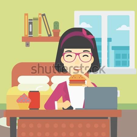 женщину еды гамбургер рабочих ноутбука Сток-фото © RAStudio