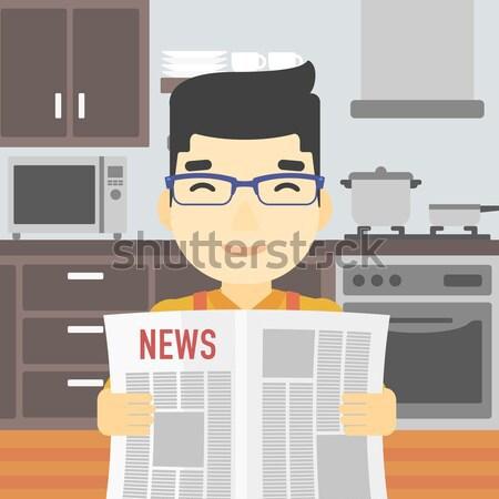 Man reading newspaper. Stock photo © RAStudio