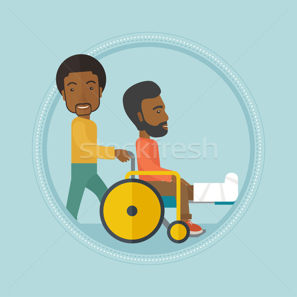 Stock photo: Man pushing wheelchair with patient.