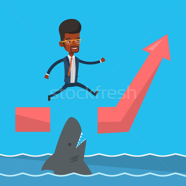 Businessman jumping over ocean with shark. Stock photo © RAStudio