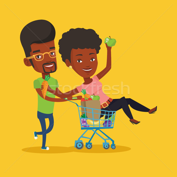 Couple of friends riding by shopping trolley. Stock photo © RAStudio