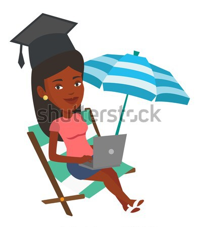 Graduate lying in chaise lounge with laptop. Stock photo © RAStudio