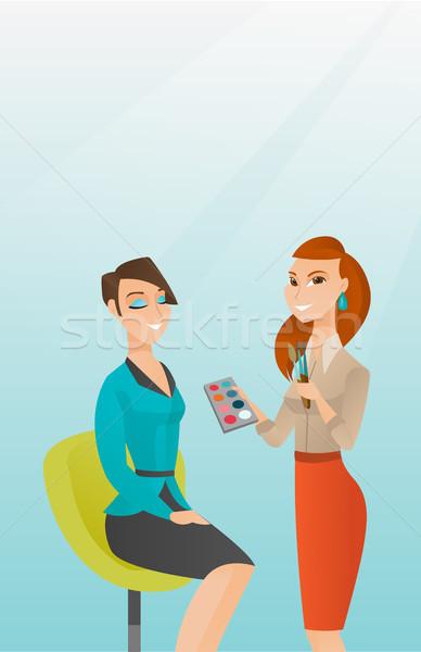 Visagiste doing makeup to young girl. Stock photo © RAStudio