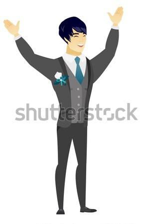 Groom standing with raised arms up. Stock photo © RAStudio
