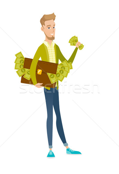 Stock photo: Caucasian businessman with briefcase full of money