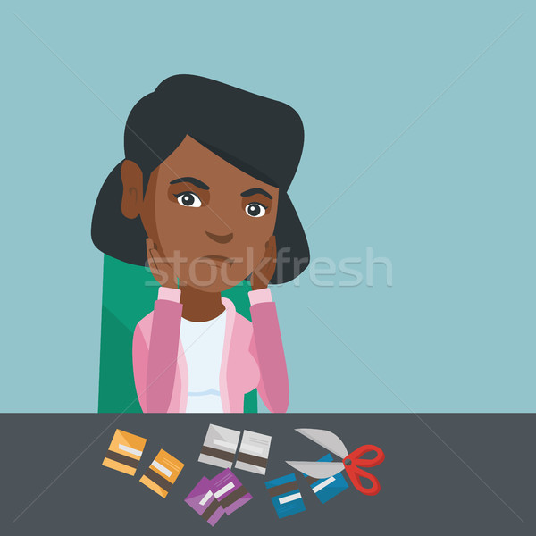 Young african-american woman cutting credit cards. Stock photo © RAStudio