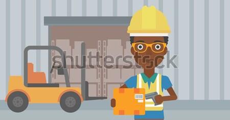 Warehouse worker scanning barcode on box. Stock photo © RAStudio