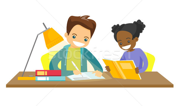 Biracial brother and sister doing homework. Stock photo © RAStudio