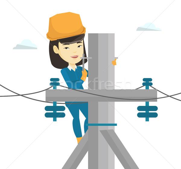 Elektrikçi çalışma elektrik güç kutup Asya Stok fotoğraf © RAStudio