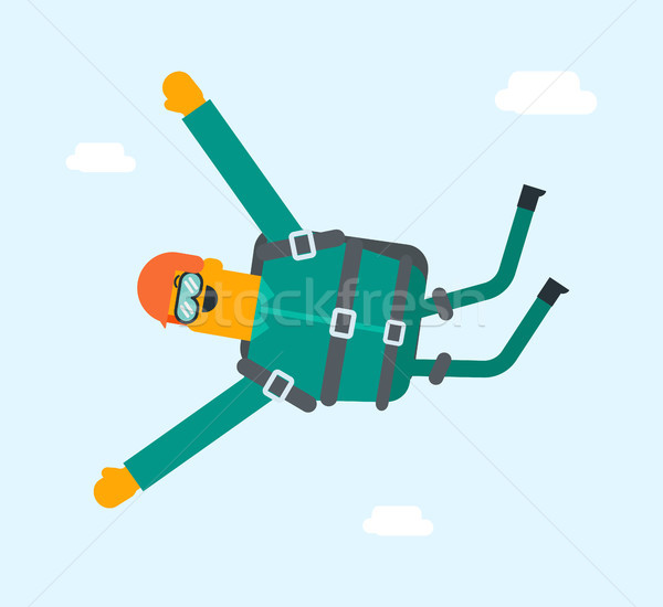 Caucasian white sportsman performing skydive. Stock photo © RAStudio