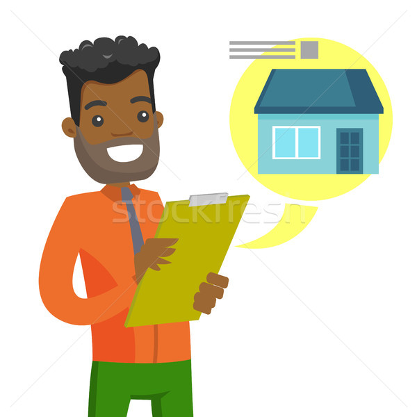 Young african man reading real estate advertising. Stock photo © RAStudio