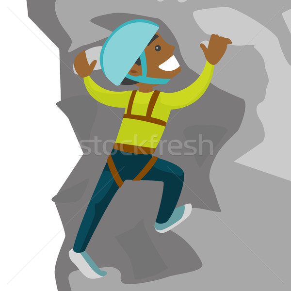 Young black man climbing on a rock. Stock photo © RAStudio