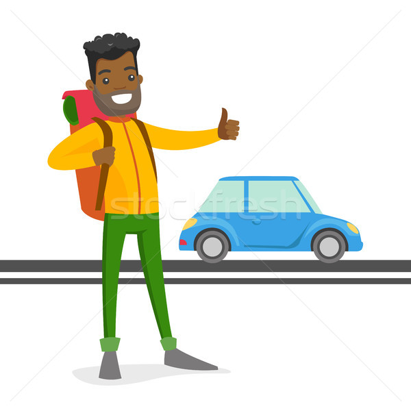 Young black man trying to stop a taxi. Stock photo © RAStudio