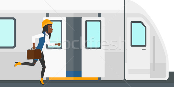Woman missing train. Stock photo © RAStudio