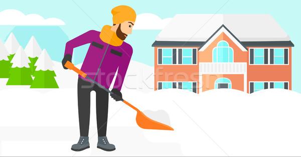 Man shoveling and removing snow. Stock photo © RAStudio