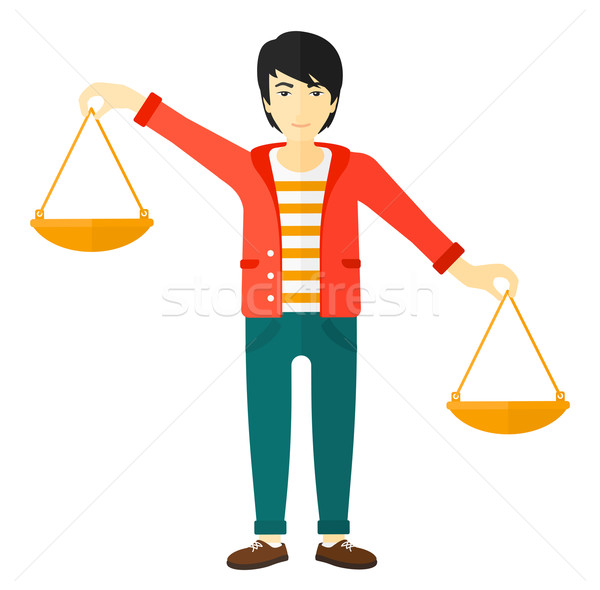 Businessman with scales. Stock photo © RAStudio
