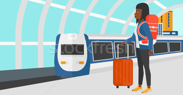 Woman with suitcase on wheels and briefcase. Stock photo © RAStudio