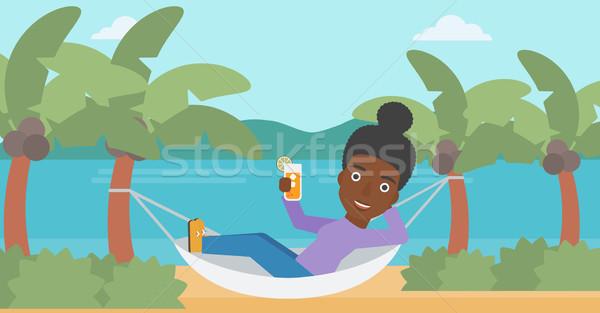 Woman chilling in hammock. Stock photo © RAStudio