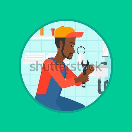 Worker hammering nail vector illustration. Stock photo © RAStudio