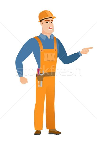 Furioso construtor gritando caucasiano indicação dedo Foto stock © RAStudio