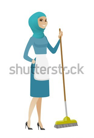 Senior housemaid sweeping floor with a broom. Stock photo © RAStudio