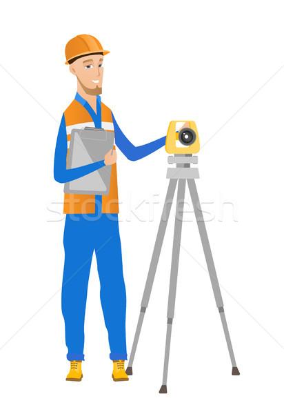 Caucasian surveyor builder working with theodolite Stock photo © RAStudio