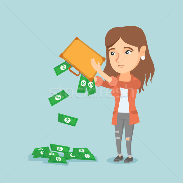 Penniless woman shaking out money from briefcase. Stock photo © RAStudio