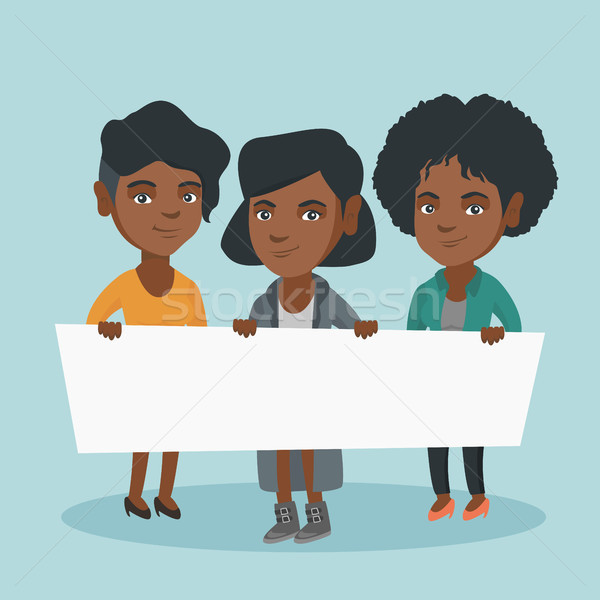 Group of young women holding a white blank board. Stock photo © RAStudio